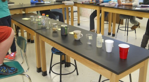 Students study the twelve different containers, using reason to deduce their thermal properties.