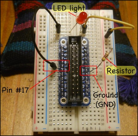 A circuit that connects the #17 GPIO pin to a red LED light then to a resistor before going back into the ground (GND).