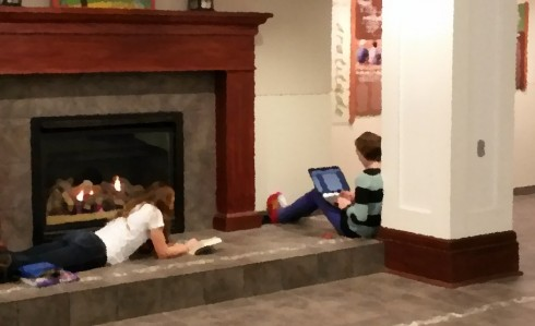 Working by the fireplace.