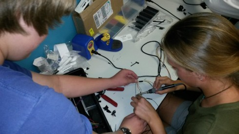 Students learn to solder.